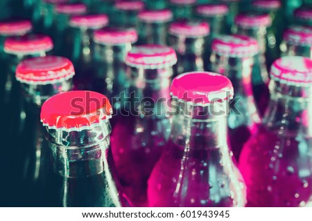 glass bottles with soft drinks background