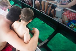 Glass bottom boat family trip
