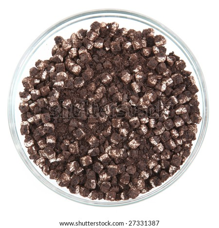 Glass bowl full of chopped chocolate cream cookies for baking or topping.