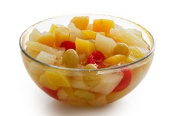 Glass bowl of fruit cocktail isolated on white.