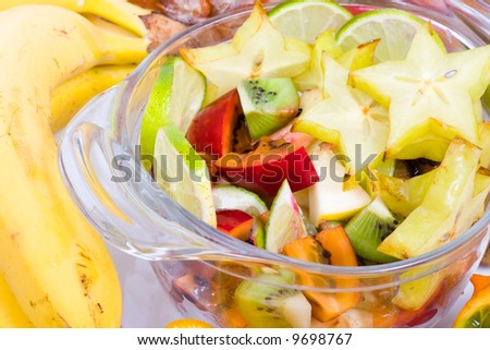 Glass bowl of salad with exotic fruits, low DOF