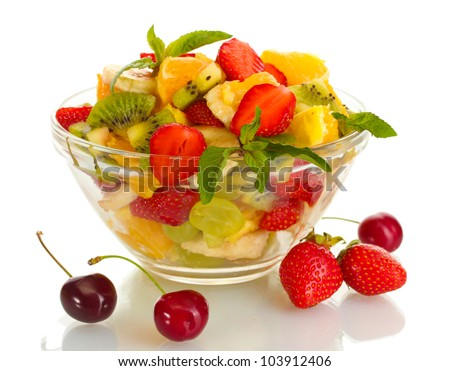 glass bowl with fresh fruits salad and berries isolated on white