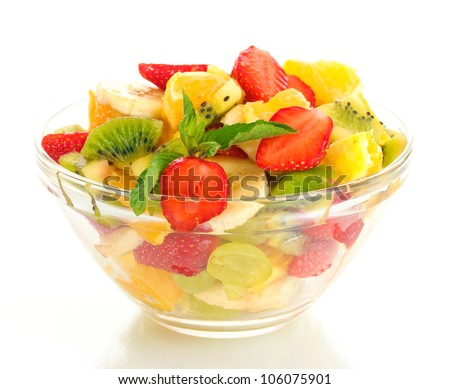 glass bowl with fresh fruits salad isolated on white