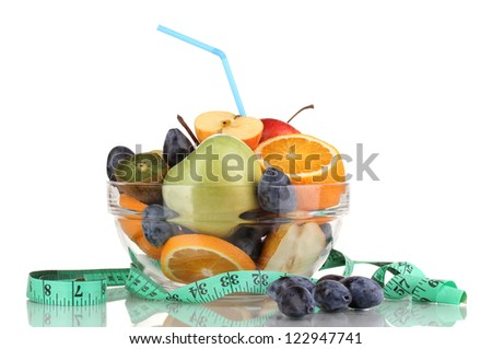 Glass bowl with fruit for diet and measuring tape isolated on white
