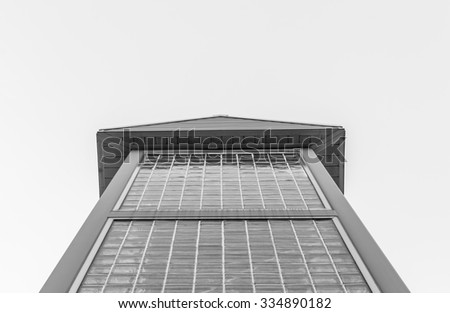 Glass brick building isolated with blue sky background. Minimal architecture glass building. Isolated architecture pyramid roof. Minimal art and design. Modern design structure. Steel. Black and white