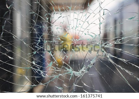 Glass broken cracks splinters in front of the bus station
