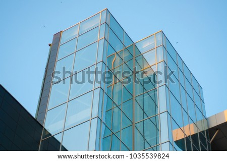 Glass building against the blue sky, multi-storey - Shutterstock ID 1035539824