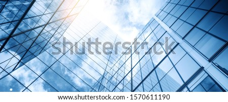 Photo of  glass buildings with cloudy blue sky background