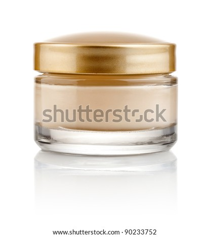 glass can with cream and gold lid isolated on white background