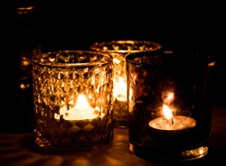 Glass candle holders with tealight candles, warm and cozy atmosphere