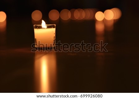 Glass candle with it's reflection