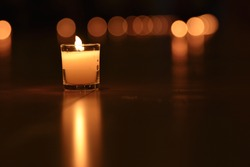 Glass candle with it's reflection (from a dark floor)