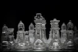 Glass chess game playing with film filter effect.