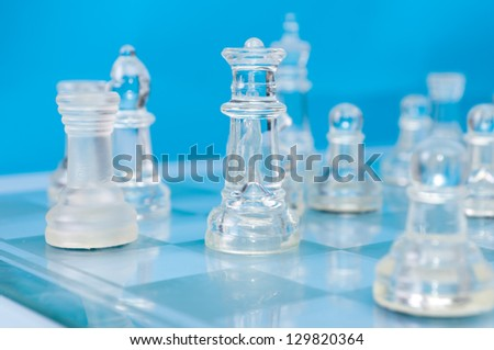 glass chess on the blue background