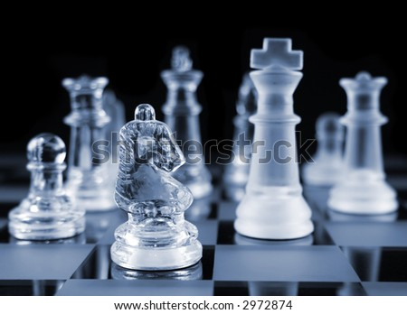 stock-photo-glass-chess-pieces-on-a-frosted-glass-chess-board-2972874.jpg