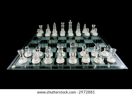 Glass Chess Pieces On A Frosted Glass Chess Board Fully