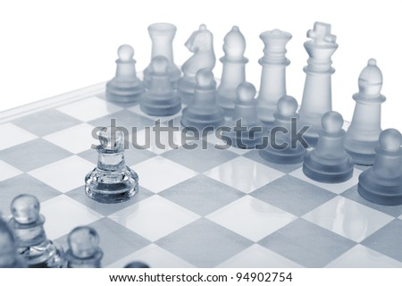 Glass chess. The first move. Blue toned.