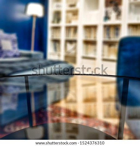 Glass coffee table of free space for your decoration. Blurred background of home interior and fall time. Warm mood photo style.  #1524376310