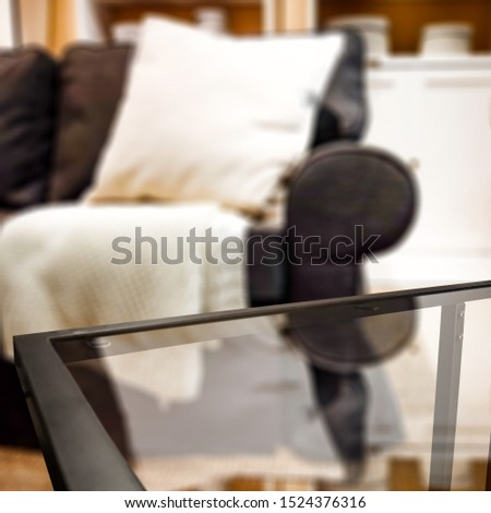 Glass coffee table of free space for your decoration. Blurred background of home interior and fall time. Warm mood photo style.  #1524376316