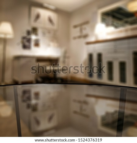 Glass coffee table of free space for your decoration. Blurred background of home interior and fall time. Warm mood photo style.  #1524376319
