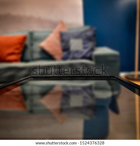 Glass coffee table of free space for your decoration. Blurred background of home interior and fall time. Warm mood photo style.  #1524376328