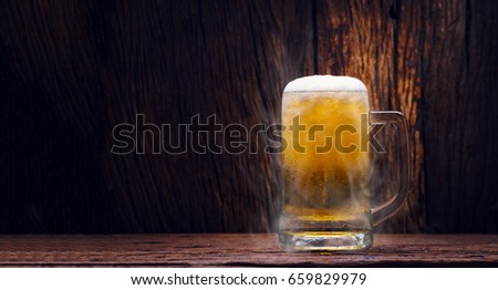 Glass cold beer on wood background with copy space #659829979