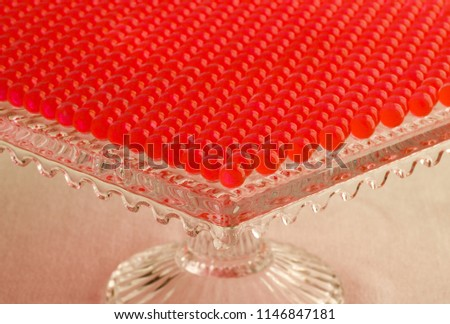 glass container for house decoration full of red hydrogel spheres lined #1146847181