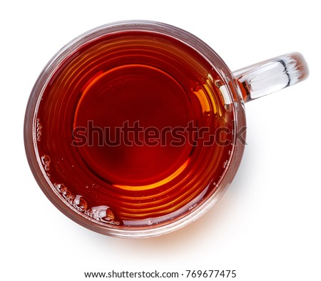 Glass cup of black tea isolated on white background. Top view
