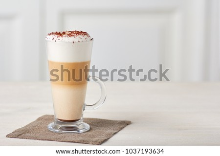 Glass cup of coffee latte on wooden table #1037193634