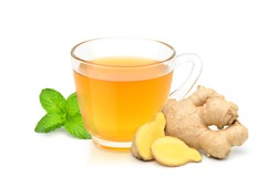 Glass cup of hot ginger tea with ginger rhizome (root) sliced and mint leaf isolated on white background.