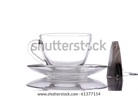 Glass Cup of Tea and tea packet