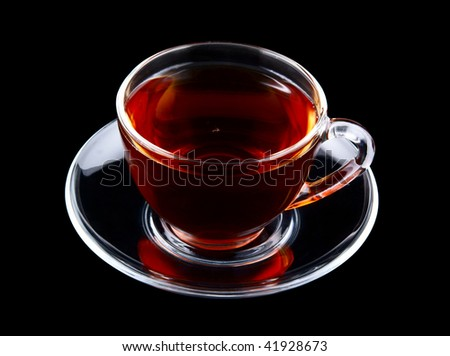 Glass cup of tea isolated on black