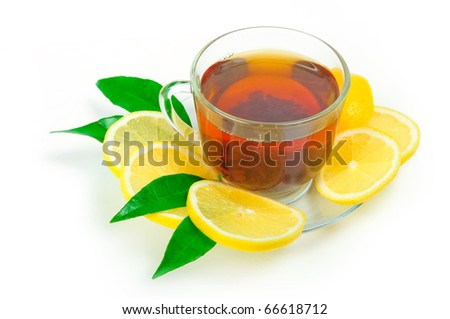 Glass cup of tea with lemon on the white background