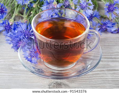 Glass cup with fragrant a cornflower tea