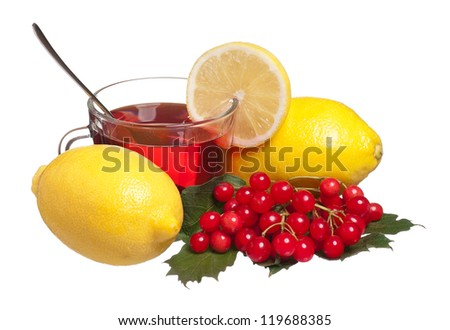 Glass cup with tea with lemons and arrow wood isolated on a white background