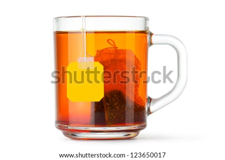 Glass cup with teabag. Isolated on a white.