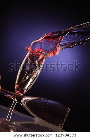 glass cups with color splashes water