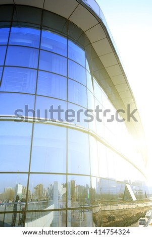 Glass curtain wall of modern office building #414754324