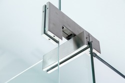 glass door hinges gray color, close up of hinged accessories of transparent partitions.