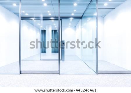 glass door with hi-tech fingerprint lock in modern building