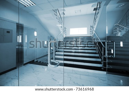 Glass doors with a kind on a marble staircase #73616968