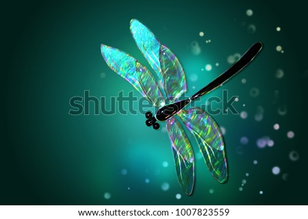 Glass dragonfly with effect of holography  on a green background with patches of light\r\r