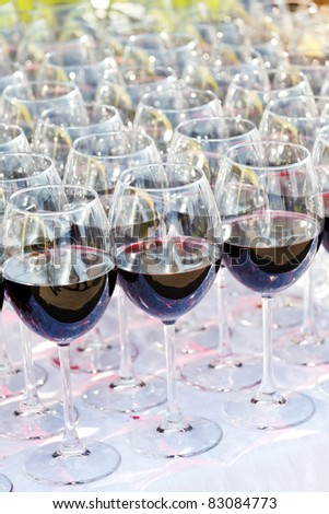 glass drink red wine on buffet outdoor party - stock photo