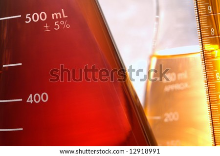 Glass Erlenmeyer flask in research lab background