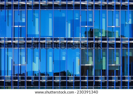 glass facade of a building with solar shading blue: detail