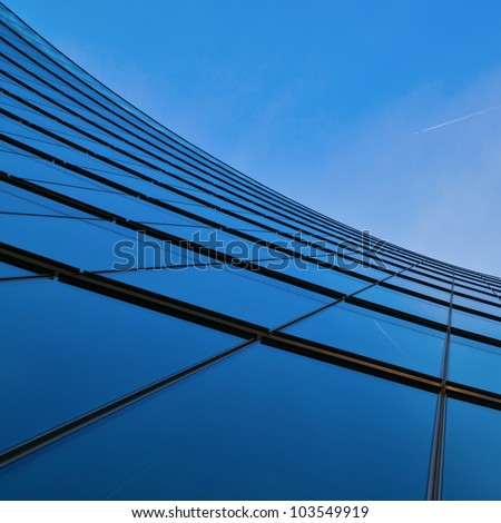 glass facade of an office building in a low angle view