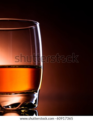 glass filled with drink, amber light