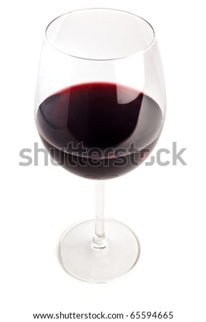 Glass filled with red wine, topshot isolated on white