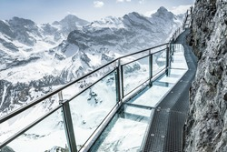 Glass floor on a thrill walk on the top of Birg, Switzerland