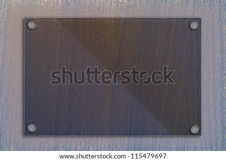 Glass frame on old wooden wall.